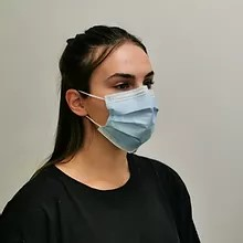 Girl wearing disposable face mask
